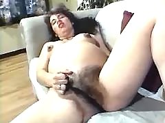 Pregnant milf enjoys dildo on sofa